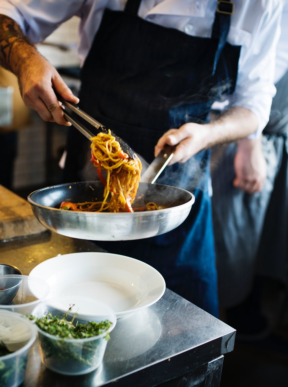 person serving pasta